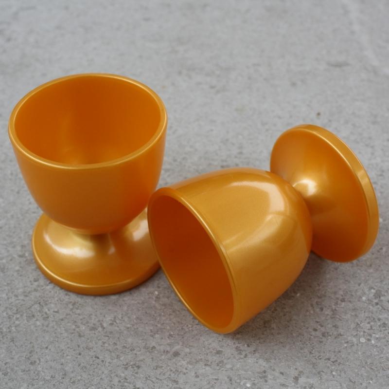 Goudgele kunststof eierdopjes