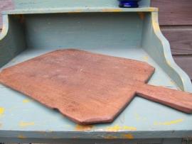 Antieke snijplank met handvat