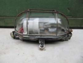 Oude kooilamp met helderglas en bakkelite voet