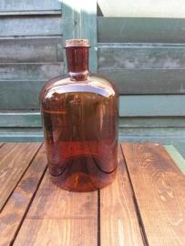 Oude bruine fles van 5 liter
