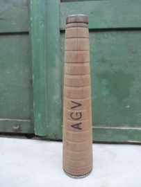 Old wooden high thread spool with the letters AGV
