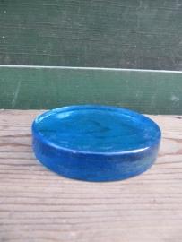 Glazen felblauwe onderzetter