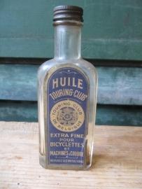 Antiek olieflesje met etiket van Touring Club de Belgique