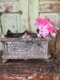 Antieke set gietijzeren jardinière