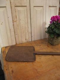 Oude houten ovenschietplank