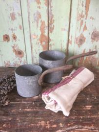 Set antieke zinken steelpannen