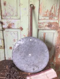 Antieke platte koperen deksel