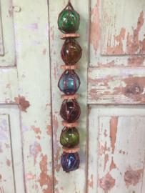 Oude kleine glazen drijvers