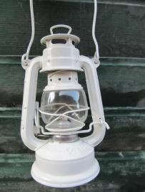 Old white oil lamp
