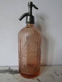 Antieke zalmkleurige spuitfles met opdruk