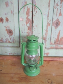 Old green oil lamp