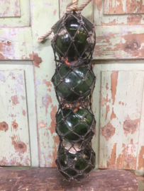 Antieke Franse glazen drijvers in net