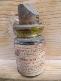 Oud frans flesje met gele verf