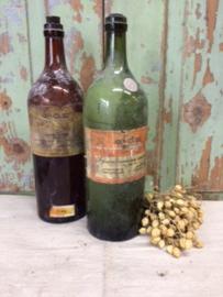 Set oude flessen met Levertraan en Kampferspiritus
