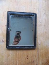 Antiek zwart spiegeltje
