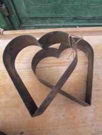 Oude brocante bakvorm in hartjesvorm