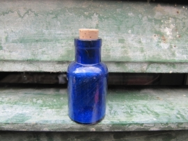 Rond Antiek Frans blauw flesje.