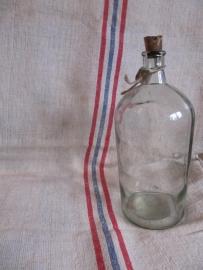 Oude brocante glazen fles.