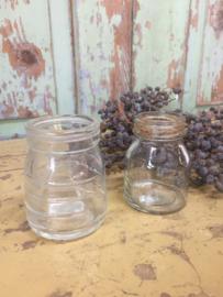 Set van 2 oude glazen potjes