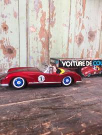 Oude race auto in doos