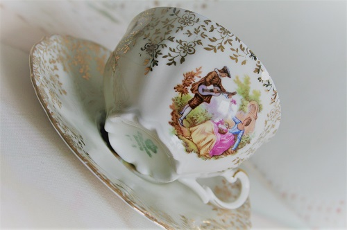 Mooie brocante kop en schotel met een afbeelding naar Fragonard
