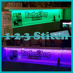 Raam bestickerd met full color logo voor de Barbershop