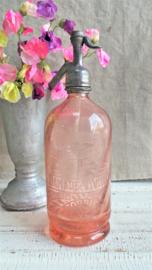 Roze spuitfles met tekst VERKOCHT