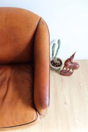 Lederen vintage club fauteuil. Toffe lounge stoel van bruin (schapen?) leer.