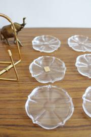 Set vintage onderzettertjes van glas in houder. 6 glazen onderzetters