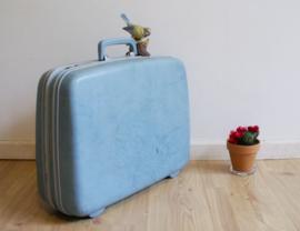 Blauwe retro Samsonite koffer. Blits vintage valies met extra tasje