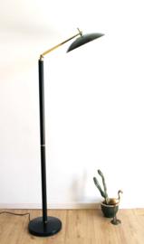 Zwarte vintage lamp met gouden details. Hollywood Regency Style vloerlamp