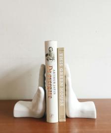 Set vintage boeksteunen in de vorm van handen. Keramieken boekensteun.