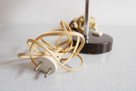 Bruine retro bureaulamp. Vintage lampje met buigbare poot