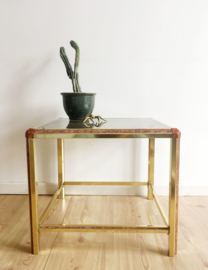 Glazen salontafel op gouden poten. Vintage bijzettafel - Hollywood Regency stijl.