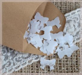 Gegomde kraftpapier strikjes bruin/wit in een pergamijn/kraft zakje