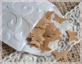 Gegomde vlindertjes bruin of wit in een pergamijn of kraft loonzakje