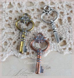 Bedel sleuteltjes metal look in 3 kleuren. Per 10