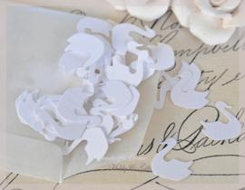 Pergamijn zakje gevuld met 100 zwanen in vele kleurtjes