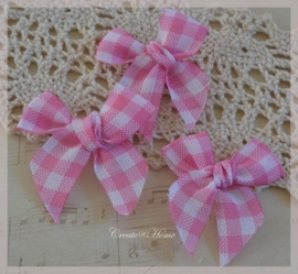 Stoffen strikjes, roze/wit geruit. Per 10