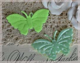 Vlindertje mintgroen met witte stippen. Per 5