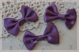 Stoffen strikjes paars. Per 10