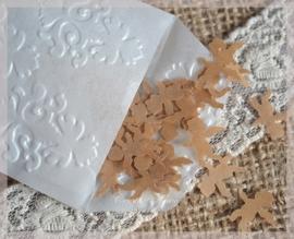 Gegomde engeltjes bruin of wit in een pergamijn of kraft loonzakje