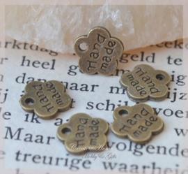 Bedel bloemetjes brons metaal Handmade. Per 10