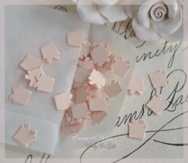 Pergamijn loonzakje gevuld met 100 cadeautjes in vele kleurtjes