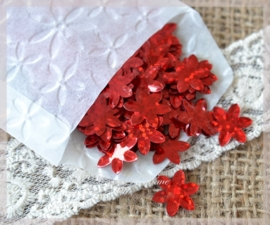 Pergamijn zakje gevuld met 192 rode kunststof bloemetjes