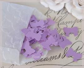 Pergamijn loonzakje gevuld met 100 strikjes in vele kleurtjes