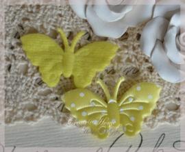 Vlindertje pastelgeel met witte stippen. Per 5
