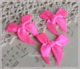 Strikjes satijn neon roze. Per 10