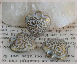 Bedel hartjes metal look goud/zilver. Per 10