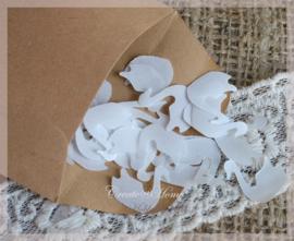 Gegomde zwanen bruin of wit in een pergamijn of kraft zakje